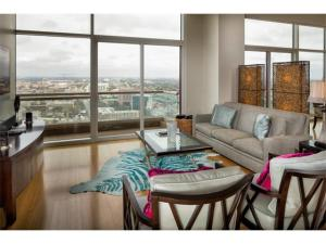 Living area with balcony.  The University of Texas stadium is in