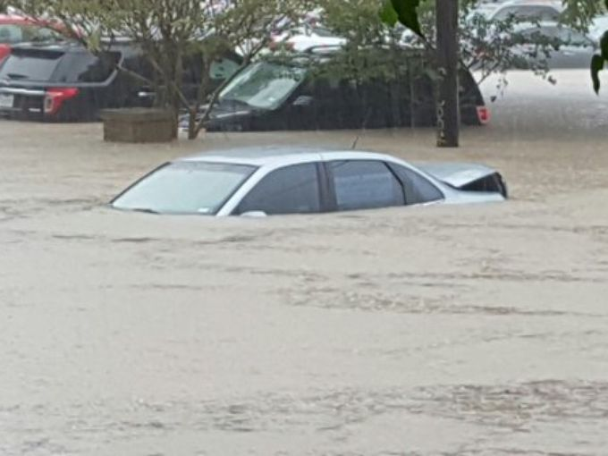 Flooded car at 1st street and Barton Springs.