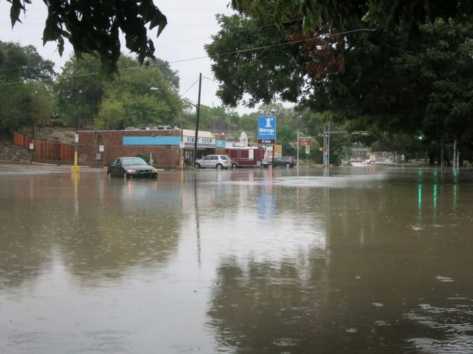 Flooded road at Barton Springs between Lamar and S. 1st.